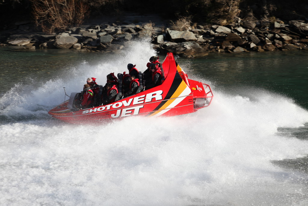 A Shotover Jet Boat halfway through a spin