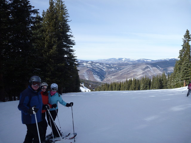 Dad, Ali and Katie skiing in Vail